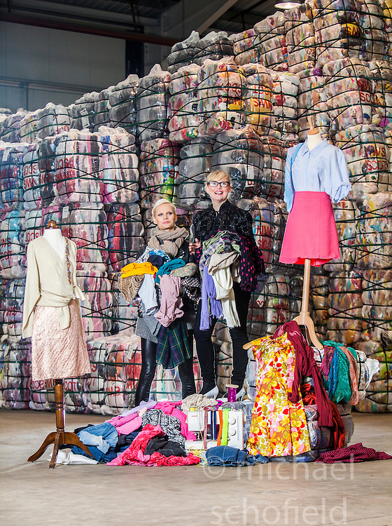 Model Anna Freemantle, and Scottish fashion designer Niki Taylor, showing fashion students about upcycling clothes, at the UK's second largest textile recycling facility, Nathan's Wastesavers, in Denny.<br /> © Michael Schofield.