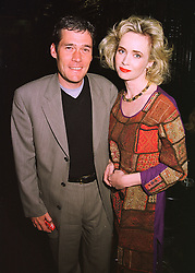 Actress LYCETTE ANTHONY and her husband MR DAVID PRICE at a fashion show on 15th April 1998.MGP 3