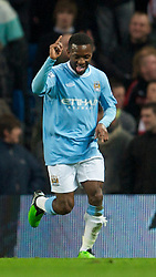 MANCHESTER, ENGLAND - Sunday, February 13, 2010: Manchester City Shaun Wright-Phillips celebrates scoring the opening goal against Stoke City during the FA Cup 5th Round match at the City of Manchester Stadium. (Photo by David Rawcliffe/Propaganda)  MANCHESTER, ENGLAND - Sunday, February 13, 2010: Manchester City xxxx and Stoke City's xxxx during the FA Cup 5th Round match at the City of Manchester Stadium. (Photo by David Rawcliffe/Propaganda)