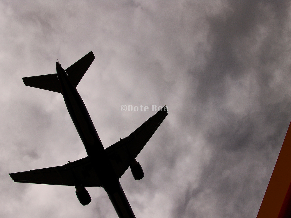 Upwards view of an flying airplane.