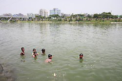 May 5, 2017 - Dhaka, BAngladesh - On the hot summer noon, Bangladeshi children play and take bathe in the polluted water of a lake at Dhaka, Bangladesh, May 5, 2017. Temperature in Dhaka reached 39 degrees Celsius on 5th May. (Credit Image: © Suvra Kanti Das via ZUMA Wire)