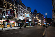 Central London looking deserted on 22nd April 2020 in London, United Kingdom, during lockdown in the UK as a result of Covid19. In order to stop the spread of the Coronavirus shops, pubs, cafes and restaurants have been closed down by law. The famous Shaftesbury Avenue in Soho / central London at night on what would normally be a bustling business / week day in London, is deserted.