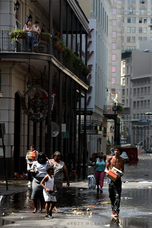 Pedestrians walk through flooded streets of the french quarter Wednesday, August 31, 2005, in New Orleans, La. Scott Morgan