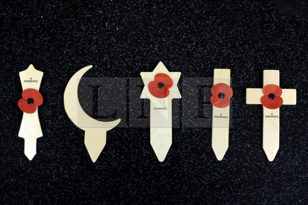 © Licensed to London News Pictures. 07/11/2011. Richmond, UK. The factory has 5 designs of symbol for use (L-R) A khanda, A Crescent (which doesn't allow other symbols to be attached) , a Star, A non denominational cross and the traditional Christian Cross. Red Poppies being made in The Poppy Factory in preparation for sale in 2012, Richmond, Surrey today 7th November.  The factory has been supplying the poppy, crosses and wreathes to the British Legion for almost 90 years. It is staffed by veterans, many whom of which are injured, sick or wounded of all ages. Photo credit : Stephen Simpson/LNP