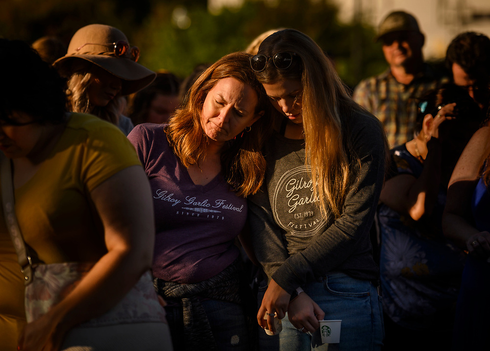 Kirstin Bright, left, leans on Jessica Bright during a vigil in Gilroy, Calif. on Monday, July 29, 2019. Kirstin was at the Gilroy Garlic Festival on Sunday when a gunman opened fire, killing at least three people and injuring 12. (Daniel Kim/Sacramento Bee)