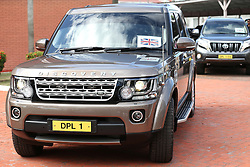 A car with a bare mast after Prince Harry's royal standard flew off his official chauffeur-driven car and blew down the road soon after he arrived in Guyana on the final stop of his 15-day tour of the Caribbean.