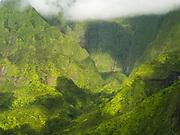 Wai' ale' ale Waterfalls - Aerial view of Kauai, Hawaii on a cloudy day.