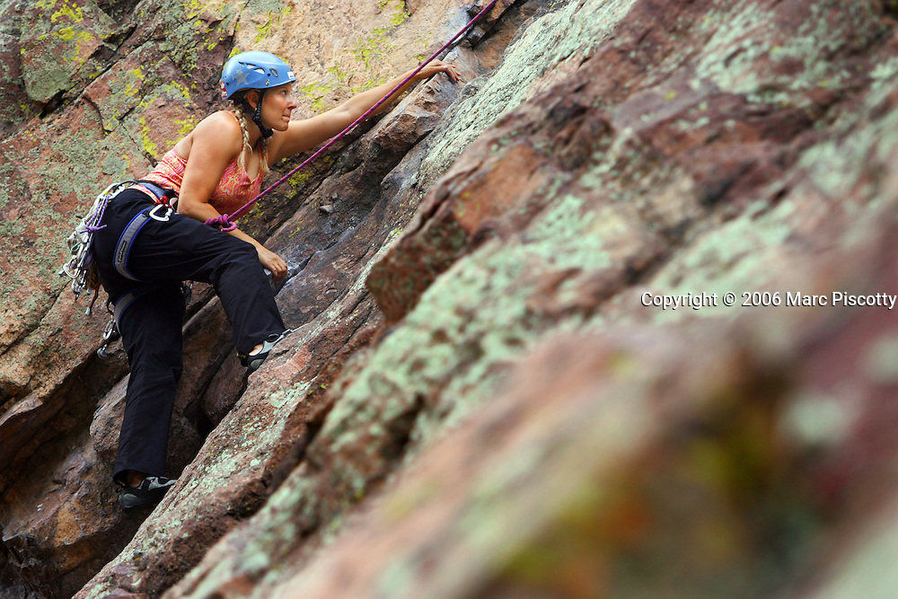 Deidre Pflaumer, 32, of Denver a member of the Denver/Boulder chapter of Sheclimbs, climbs the Calypso route (rated 5.7) in Eldorado Canyon on Tuesday August 8, 2006. Sheclimbs started in January 1995 as a group of 25 women in Portland, Oregon who wanted to have the opportunity to climb with other women and provide an environment in which women would excel at the sport. There are more than 60 members in the Denver/Boulder chapter. Pflaumer was a member of Sheclimbs in the Washington D.C. area and said it was the first thing she looked for after moving to Colorado and added that she has met some of her best friends and climbing partners through the group..(MARC PISCOTTY/ © 2006)