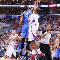 11 May 2014: Jump ball between Oklahoma City Thunder forward Kevin Durant (35) and Los Angeles Clippers guard Chris Paul (3) during the Los Angeles Clippers 101-99 victory over the Oklahoma City Thunder, during Game Four of the Western Conference Semifinals of the NBA Playoffs, at the Staples Center, Los Angeles, California, USA.