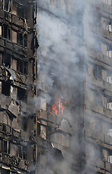 Smoke billows from a fire that has engulfed the 27-storey Grenfell Tower in west London.