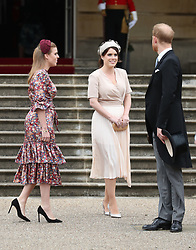Princess Eugenie (centre), Princess Beatrice and the Duke of Sussex during a Royal Garden Party at Buckingham Palace in London.