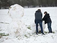 Kids making a snowman Stratton Audley Oxfordshire photo by Brian Jordan 24th jan 2021