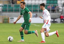 Republic of Ireland's Lee O'Connor (left) and Luxembourg's Alexandre Sacras battle for the ball during the UEFA Under-21 Championship Qualifying Round Group F match at the Tallaght Stadium, Dublin. Picture date: Friday October 8, 2021.