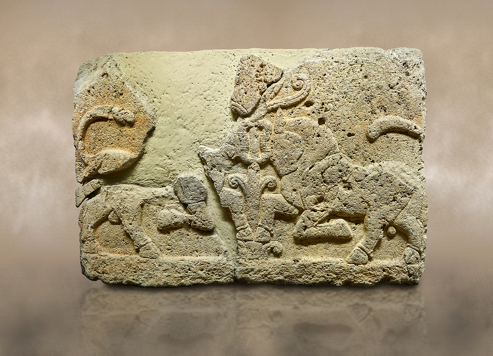 Hittite relief sculpted orthostat stone panel of Herald's Wall Limestone, Karkamıs, (Kargamıs), Carchemish (Karkemish), 900-700 B.C. Anatolian Civilisations Museum, Ankara, Turkey.<br /> <br /> A pair of kneeling bull on either side of the tree of life, one each foot is on the tree, the other feet are bend towards the abdomen.  <br /> <br /> Against a brown art background. .<br />  <br /> If you prefer to buy from our ALAMY STOCK LIBRARY page at https://www.alamy.com/portfolio/paul-williams-funkystock/hittite-art-antiquities.html  - Type  Karkamıs in LOWER SEARCH WITHIN GALLERY box. Refine search by adding background colour, place, museum etc.<br /> <br /> Visit our HITTITE PHOTO COLLECTIONS for more photos to download or buy as wall art prints https://funkystock.photoshelter.com/gallery-collection/The-Hittites-Art-Artefacts-Antiquities-Historic-Sites-Pictures-Images-of/C0000NUBSMhSc3Oo