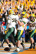 North Dakota State Bison tight end Garrett Bruhn (47) grabs North Dakota State Bison running back Sam Ojuri (22) to celebrate a touchdown during the FCS title game against Sam Houston State at FC Dallas Stadium in Frisco, Texas, on January 5, 2013.  (Stan Olszewski/The Dallas Morning News)