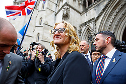 © Licensed to London News Pictures. 24/03/2017. London, UK. CLAIRE BLACKMAN (C), wife of Sergeant Alexander Blackman, leaves the Royal Courts of Justice in London, where sentencing of Sgt Blackman is delayed until next Tuesday. Also known as Marine A, Sgt Blackman's life sentence was reduced to manslughter for killing a wounded Taliban fighter in Afghanistan in 2011. Photo credit: Tolga Akmen/LNP