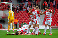 Doncaster Rovers celebrate as forward John Marquis scores his second goal of the match 2-0 during the EFL Sky Bet League 1 match between Doncaster Rovers and Bradford City at the Keepmoat Stadium, Doncaster, England on 22 September 2018.