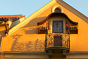 Czeck Republic - Prague, Czeck Republic, Prague, house with wrought iron rail casting long shadows.
