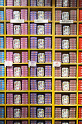Traditional canned fish mackerel, tuna, sardines, cod roe, stacked on shelves for sale in food shop in Aveiro, Portugal