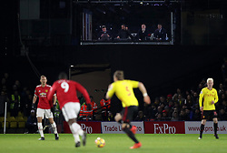 BT Sport presenter Jake Humphrey (L - R) alongside pundits Rio Ferdinand, Paul Scholes and Jermaine Jenas wach the game from the tv studio during the Premier League match at Vicarage Road, Watford.