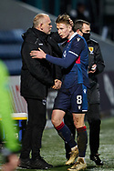 Oli Shaw of Ross County gets a shake of the hand and pat on the head after being substituted during the Scottish Premiership match between Ross County FC and Aberdeen FC at the Global Energy Stadium, Dingwall, Scotland on 16 January 2021.