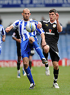 Picture by Graham Crowther/Focus Images Ltd. 07763140036.31/03/12.Rob Jones of Sheffield Wednesday fights fot yhe ball with Graham Cummins of Preston North End during the Npower League 1 match at Hillsborough stadium, Sheffield..