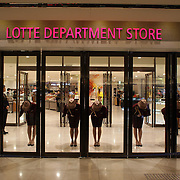 The regimental opening of the doors at morning opening time at the Lotte department store, Lotte World. Lotte World is the world's largest indoor theme park which includes shopping malls, a luxury hotel, and an Ice rink. Opened on July 12, 1989, Lotte World receives over 8 million visitors each year. Seoul, South Korea. 21st March 2012. Photo Tim Clayton