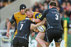 Will Hurrell of Bristol Rugby is tackled by Will Welch (capt) and David Wilson of Newcastle Falcons - Rogan Thomson/JMP - 08/10/2016 - RUGBY UNION - Kingston Park - Newcastle, England - Newcastle Falcons v Bristol Rugby - Aviva Premiership.