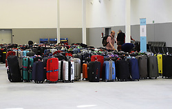 April 18, 2018 - Palma, Balearic Islands, Spain - The passengers deposit their suitcases in the hall of the marine station before boarding on the ship. The Cruise ship ''Mein Schiff 6'' arrives for the first time in the port of Palma de Mallorca. The ship has 15 decks and can transport about 2700 passengers and 1000 crew. It is the newest boat of the company TUI Cruises, 80% of the passengers on board are Germans. (Credit Image: © Clara Margais via ZUMA Wire)