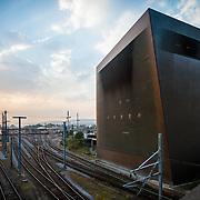 """Basel's central railway signal box affectionately known as the """"Copper Tower"""". Design by architects Jacques Herzog and Pierre de Meuron. The copper coiling of the building acts as a Faraday cage protecting the sensitive electronic equipment of the signal box from lightning strikes."""