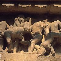 Asia, India, Khajuraho. Detail of temple carving depicting earthly desires at Khajuraho.
