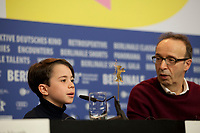 Actor Federico Ielapi and Roberto Benigni at the photocall for the film Pinocchio at the 70th Berlinale International Film Festival, on Sunday 23rd February 2020, Hotel Grand Hyatt, Berlin, Germany. Photo credit: Doreen Kennedy