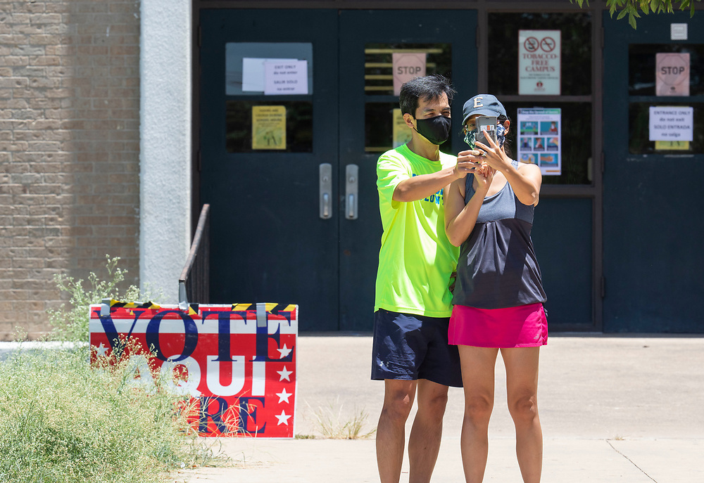 Masked voter take a selfie after exiting a polling place in south Austin Texas to vote in a  primary runoff election determining  match-ups for the November general elections. Although heavy by runoff standards, in-person voting is expected to still be less than 10% of registered Texans.