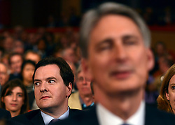 © Licensed to London News Pictures. 03/10/2012. Birmingham, UK Chancellor of the Exchequer, George Osborne sits behind Defence Secretary Philip Hammond whilst they listen to William Hague's speech on Day 1 at The Conservative Party Conference at the ICC today 7th October 2012. Photo credit : Stephen Simpson/LNP