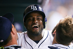 September 15, 2017 - St. Petersburg, Florida, U.S. - WILL VRAGOVIC       Times.Tampa Bay Rays shortstop Adeiny Hechavarria (11) hugs first baseman Logan Morrison (7), left, and right fielder Steven Souza Jr. (20), right, after his solo home run in the sixth inning of the game between the Boston Red Sox and the Tampa Bay Rays at Tropicana Field in St. Petersburg, Fla. on Friday, Sept. 15, 2017. (Credit Image: © Will Vragovic/Tampa Bay Times via ZUMA Wire)