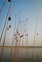 Lanterns on poles on the banks of the River Ganges in Varanasi, Uttar Pradesh, India