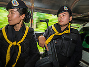 17 JUNE 2015 - RANGAE, NARATHIWAT, THAILAND:  Thai Army women Rangers ride in the back of an unarmored pickup truck during a mission in an area where there's been a lot of insurgent activity. There are 5 platoons of women Rangers serving in Thailand's restive Deep South. They generally perform security missions at large public events and do public outreach missions, like home wellness checks and delivering food and medicine into rural communities. The medics frequently work in civilian clothes because the Rangers found people are more relaxed around them when they're in civilian clothes. About 6,000 people have been killed in sectarian violence in Thailand's three southern provinces of Narathiwat, Pattani and Yala since a Muslim insurgency started in 2004. Attacks usually spike during religious holidays. Insurgents are fighting for more autonomy from the central government in Bangkok.    PHOTO BY JACK KURTZ