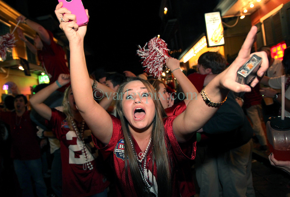 09 January 2012. New Orleans, Louisiana, USA.  <br /> BCS Championship. The Crimson Tide rolls over LSU as Alabama trounces LSU 21-0 to take the Championship for the second year in a row. Students and fans pored onto Bourbon Street as the partying carried on late into the night. Alabama fans celebrated as LSU fans commiserated.<br /> Photos; Charlie Varley