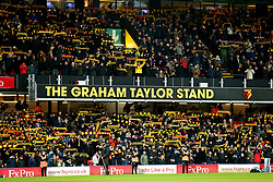 Watford fans show support for their team in the The Graham Taylor Stand during the Premier League match at Vicarage Road, Watford.