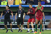Portugal Forward Cristiano Ronaldo celebrates from the bench during the Euro 2016 final between Portugal and France at Stade de France, Saint-Denis, Paris, France on 10 July 2016. Photo by Phil Duncan.