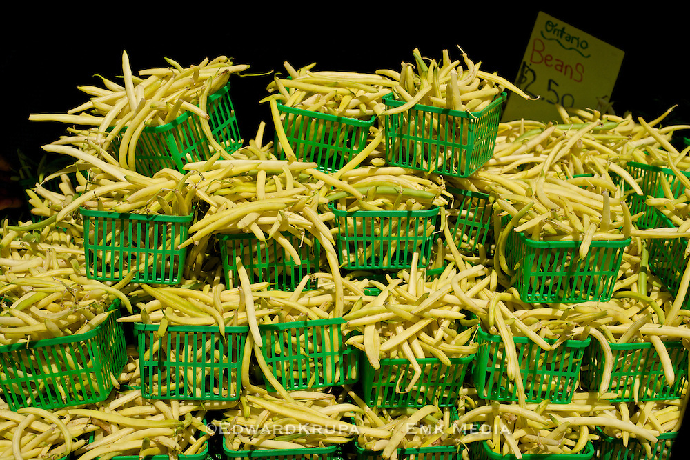 Fresh yellow wax beans at a farmers market. St. Lawrence Market, Toronto, Ontario, Canada.
