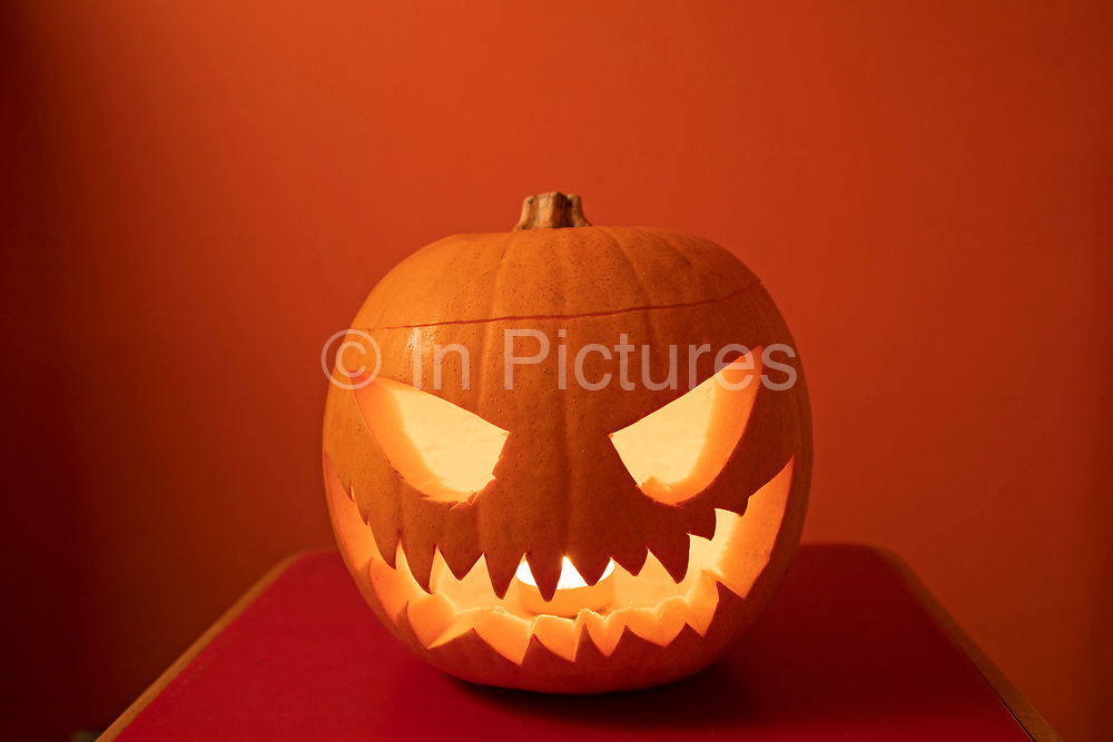 Halloween pumpkin, London, United Kingdom. Halloween, also known as All Hallows Eve, or All Saints Eve, is a celebration observed in a number of countries on 31st October, the eve of the Western Christian feast of All Hallows Day. It begins the three-day observance of Allhallowtide, the time in the liturgical year dedicated to remembering the dead, including saints hallows, martyrs, and all the faithful departed. Carving pumpkins into jack-o-lanterns is a popular Halloween tradition that originated hundreds of years ago in Ireland. Back then, however, jack-o-lanterns were made out of turnips or potatoes; it wasnt until Irish immigrants arrived in America and discovered the pumpkin that a new Halloween ritual was born.