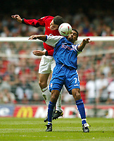 Photo: SBI/Digitalsport<br /> NORWAY ONLY<br /> <br /> Manchester United v Millwall. FA Cup Final. 22/05/2004.<br /> Paul Ifill holds the ball up from John O'Shay
