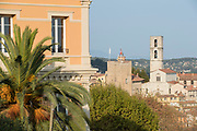 Old town buildings with bell tower of Grasse Church view behind renovated house facade, Grasse, France