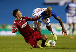 Swansea's Roque Mesa challenges Reading's Leandro Bacuna during the Carabao Cup, third round match at the Madejski Stadium, Reading.