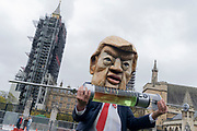 "Ten days ahead of the US Presidential elections, a Donald Trump lookalike holds a symbolic syringe containing the hormones that protesters say will be injected into livestock and sold to UK consumers if the UK negotiates a trade deal with the US, on 24th October 2020, in Westminster, London, England. Organisers, Global Justice Now say, ""The trade deal could lead to the NHS being opened up permanently to American healthcare companies; chlorinated chicken and hormone-fed beef; forced deregulation of the UK's environmental laws, workers' rights and rights to data privacy; and new rules that make it impossible to take effective action on the climate crisis."""