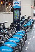 Bikes lined up in the Barclay Cycle Hire stand, London. Part of Transport for London.