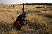 A Turkana man takes a defensive position.