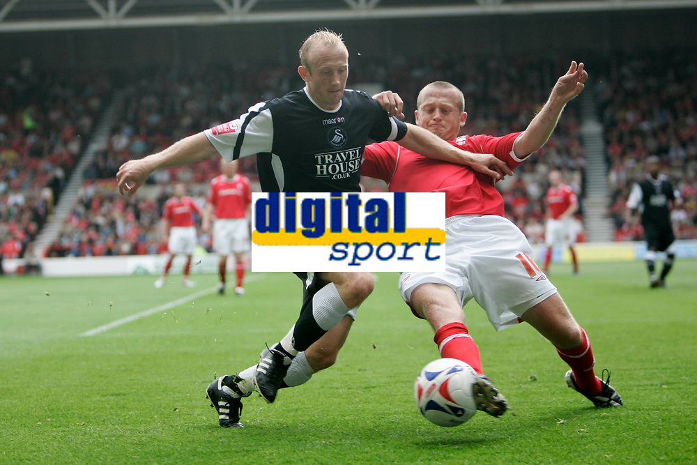 Photo: Pete Lorence.<br />Nottingham Forest v Swansea City. Coca Cola League 1. 30/09/2006<br />Darren Way tries to evade a tackle by Nottingham's Sammy Clingan.