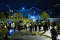 © Licensed to London News Pictures. 09/05/2021. Bolton, UK. Dozens of police at the scene . Bolton Wonderers supporters celebrate outside the team hotel at the University of Bolton stadium after BWFC won promotion to League One following the team's 1-4 victory over Crawley Town . Photo credit: Joel Goodman/LNP